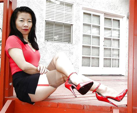 Mature Asian Lady In Seamed Stockings And Red High Heels
