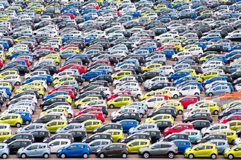 Many Small Cars On Outdoor Parking In Copenhagen Harbor