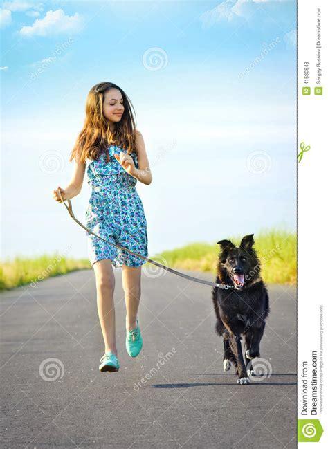 girl   dog   walk stock photo image  positive