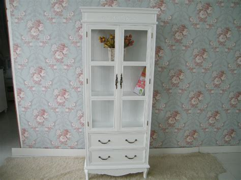 shabby chic door shabby chic white bookshelf with glass doors and drawers front of floral wallpaper picture