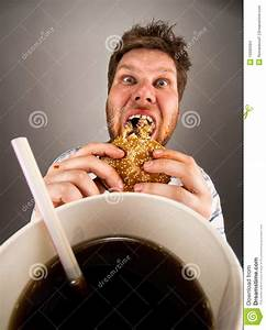 Man eating fast food stock photo. Image of holding, chew ...