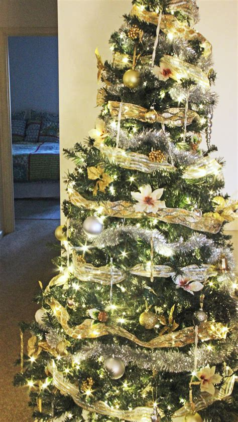 how to decorate a christmas tree from start to finish how to light ribbon and decorate a tree