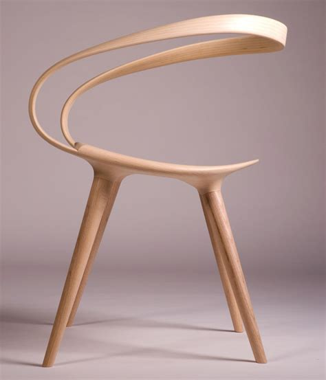 chaise designer the velo chair uses a single of bent wood as the