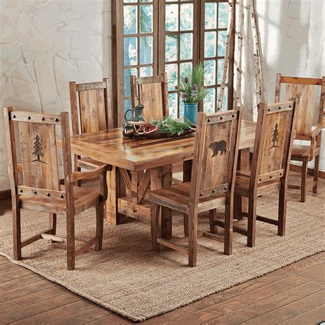 reclaimed wood dining chairs with nature carvings