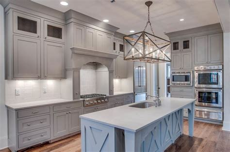 gray kitchen cabinets with stainless steel appliances grey kitchen cabinets white backsplash stainless steel