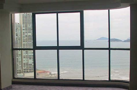 floor l in front of window photo exle of a floor to ceiling window in a city high rise building on an ocean front