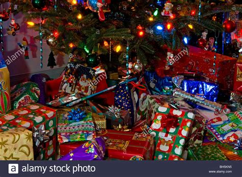 christmas presents and gifts under a christmas tree on