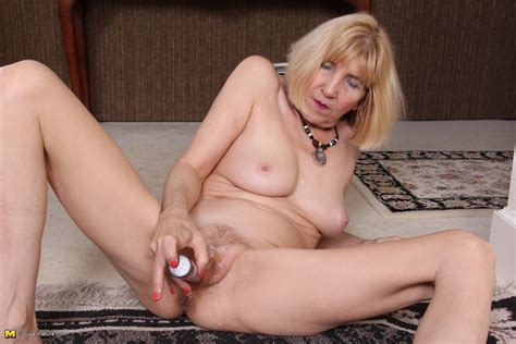Naughty American mature lady teasing and playing ...