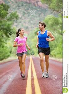 Two People Jogging For Fitness Running On Road Stock Image ...