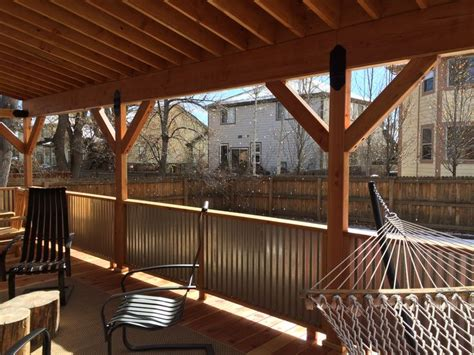 covered deck  corrugated metal roof  rails