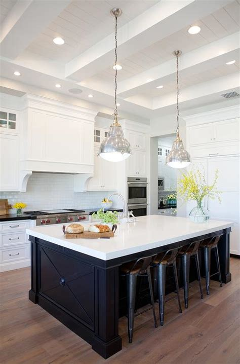 white kitchen with black island black center island with gray wash wood floors 1830