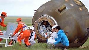 Chinese astronauts back to Earth after mission hailed ...