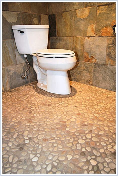 mosaic tile mirrors the river pebble floor what is the color of