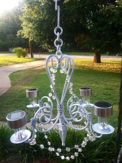 My homemade outdoor glitzy solar chandelier. Cut off stems