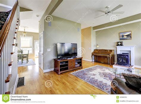 Living Room Interior With Fireplace And Piano Stock Photo