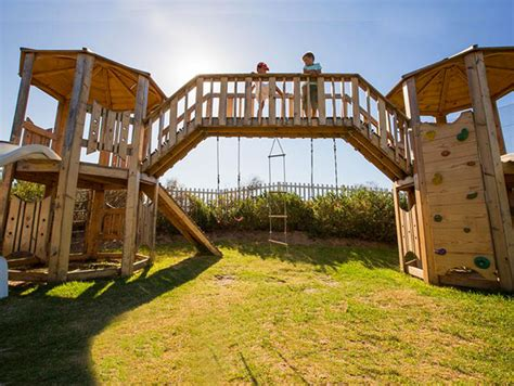 jungle gym playgrounds wooden elements