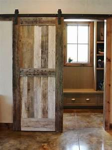 sliding barn door by resort custom homes design With barnwood door ideas