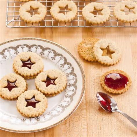 Dressed up with green food coloring and red candies, they're a fun addition to cookie platters and dessert buffets. Linzer Sandwich Cookies   America's Test Kitchen
