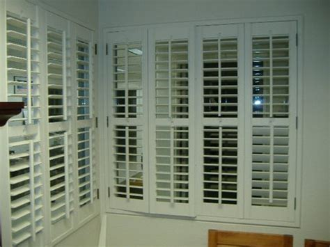outward plantation shutter windows  protect  house