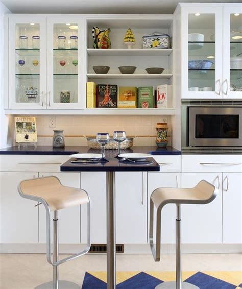 Decorating Ideas For Glass Kitchen Cabinets by Glass Cabinets For A Cool Contemporary Kitchen