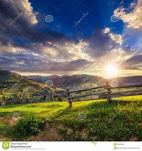 Wooden Fence In The Grass On The Hillside At Sunset Stock ...