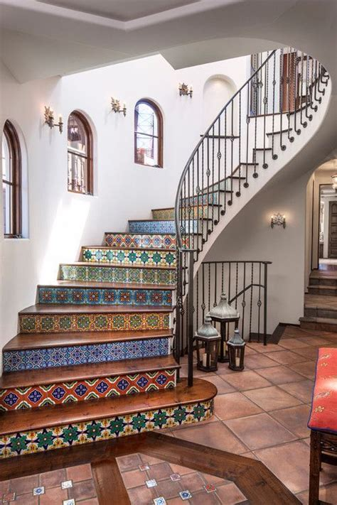 stunning spanish tiled spiral staircase  wrought iron banister  terracotta tile floors