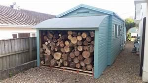 Ship Lap Shed And Log Store With Curved Roof  Unique