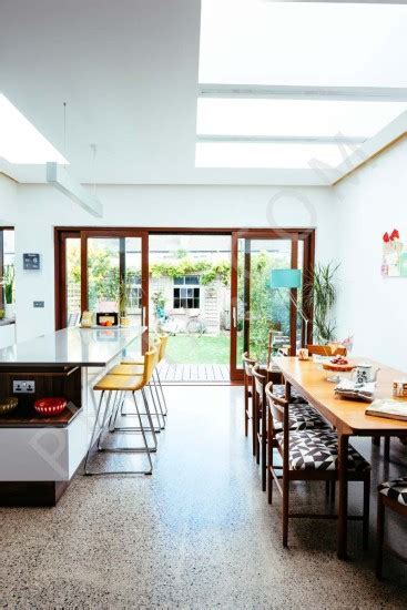 Contemporary kitchen extension with retro furniture