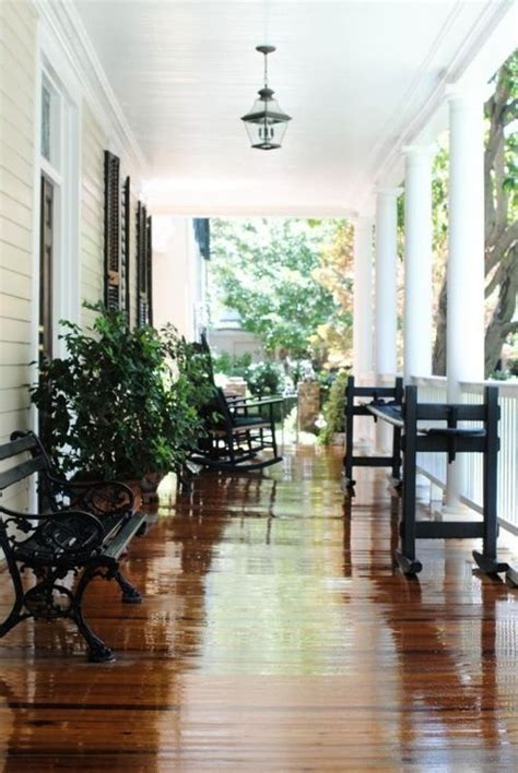 pale yellowcream house white trim white porch railings