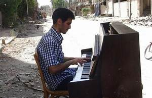 His piano burned by IS, Syrian musician joins refugee tide ...