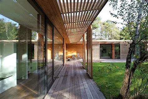glass  wood atrium home design surrounded  young