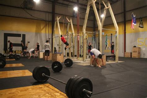 climbing rope surrounded  pull  bars crossfit