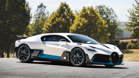 It s also the supercar through which bugatti revived its coachbuilding tradition after (.) the divo isn't bugatti's first attempt to turn the chiron into a better car at the track. The First 40 Bugatti Divo On The Way To Owners