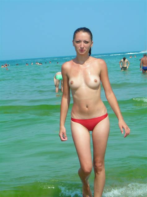Topless And Wet Girl Wearing Red Thongs Naked Girls