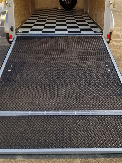 Rubber coin floor, low rider pan, recessed wheel chocks diamond plate rubber flooring for the race trailer Options - USA Cargo Trailer