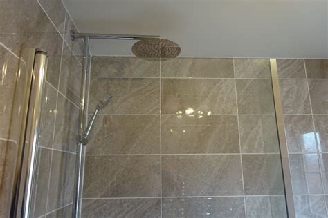 Bathroom fitted with L Shaped Shower Bath Banner Brook