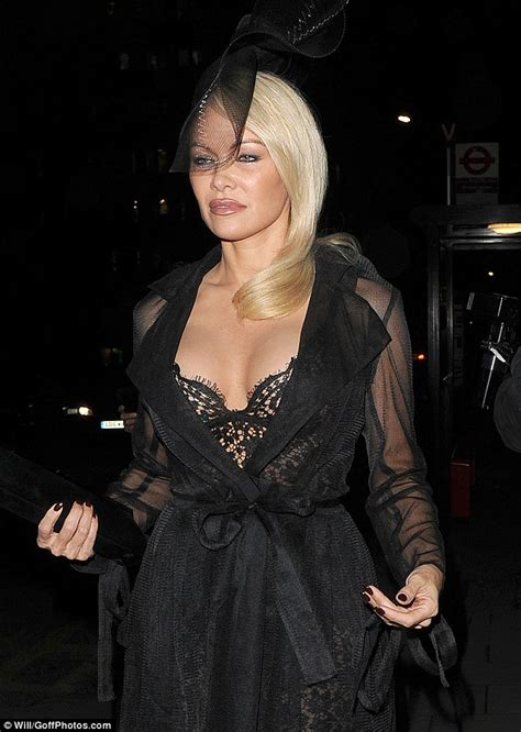 pamela anderson flashes famous cleavage  london daily