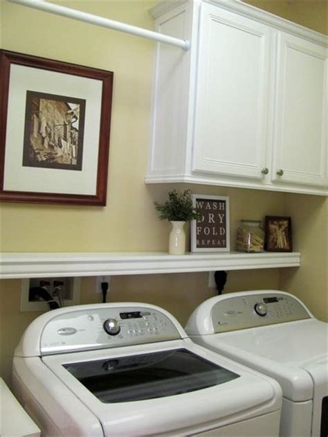 cabinets over washer and dryer laundry room ideas cabinet shelf and hanging rod i