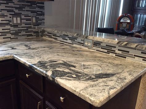 silver cloud granite countertops with backsplash tiles