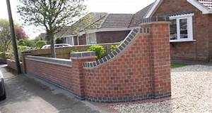 front wall design curved with grey coping stones garden With front garden brick wall designs