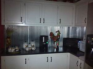 Best 25 sheet metal backsplash ideas on pinterest sheet for Kitchen cabinets lowes with metal wall art with crystals