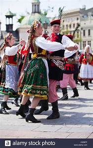 Poland, Cracow. Polish girls and boys in traditional dress ...