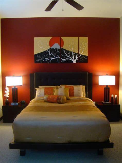 white ceiling orange paint wall zen bedroom ideas  cream bedding  blak frame ad twin