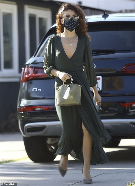 Sarah Hyland looks effortlessly chic in a plunging wrap ...