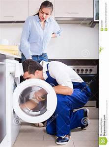 Repairman And Woman Near Washing Machine Stock Photo ...