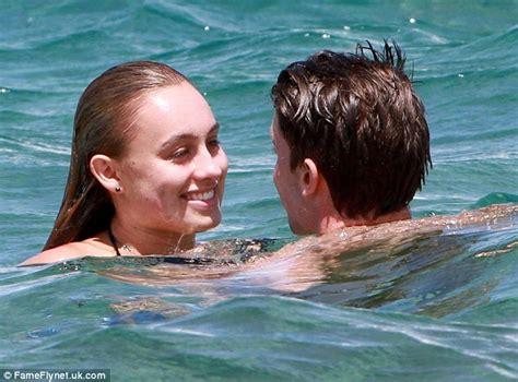 Patrick Schwarzenegger enjoys an amorous sea smooching ...