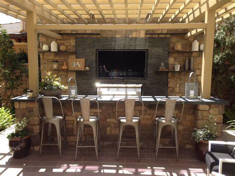 tv wall  outdoor kitchen outdoor kitchen modern