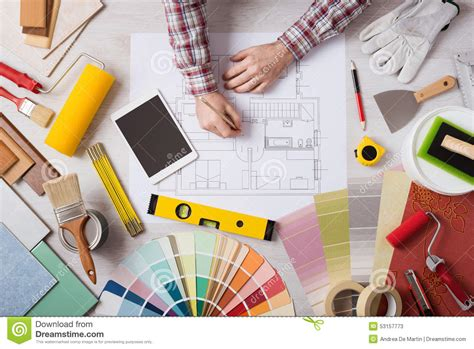paint color tools for designers professional decorator working at desk stock image image