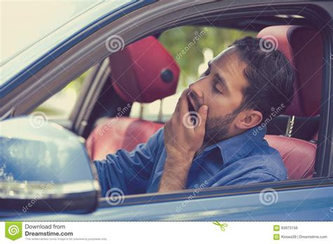 Young Guy With Alcohol And Driving Stock Image