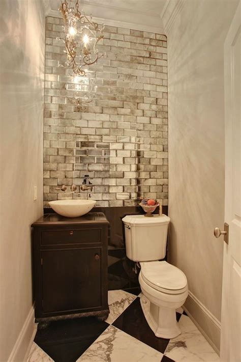 mirrored subway tiles in small powder room interiors